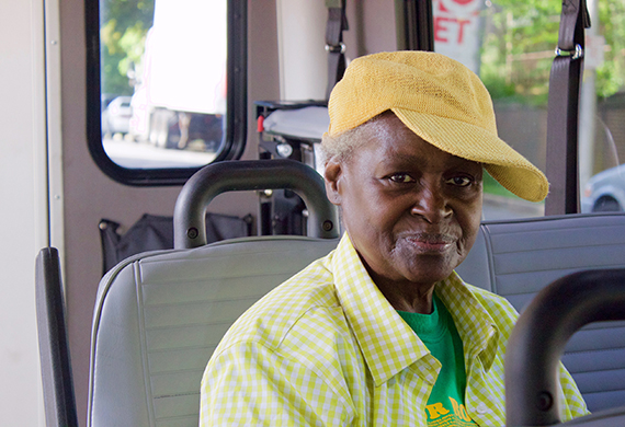 paratransit passenger seated on the vehicle