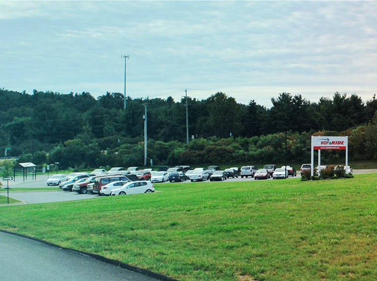 park and ride wide shot with vehicles