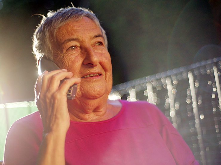 old woman talking to mobile