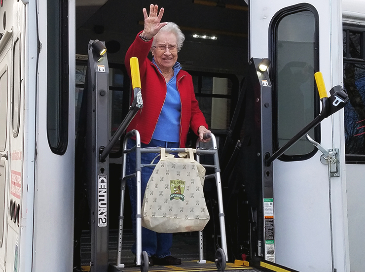 woman-with-mobility-device exiting a bus